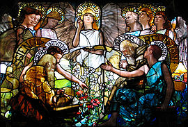 A stained glass window from 1890 by Louis Tiffany, representing the unification of science and faith